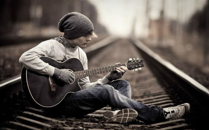 Stylish Awesome Boys Facebook Profile Pictures In A Railway Track With Guitar